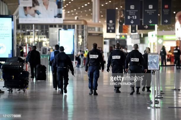 Policemen patrol at the Paris-Charles de Gaulle airport in Roissy-en-France on May 12, 2020.