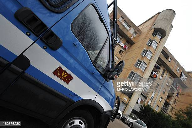 Policemen patrol in the Scampia area in the suburb of Naples on January 28 2013 The northern Neapolitan suburb of Scampia is notorious for its drug...