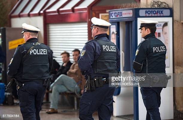 Policemen patrol on March 25 2016 in front of the main station in Giessen After a statement of the public prosecutor's office a 28yearold Moroccan...