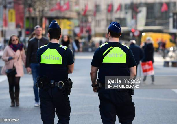 Policemen patrol on the Meir, Antwerp's main pedestrian street, after a man was arrested after he tried to drive into a crowd of shoppers at high...