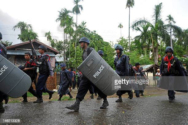 Policemen patrol the streets amid ongoing violence in Sittwe, capital of Myanmar's western state of Rakhine, on June 12, 2012. Dozens of people have...