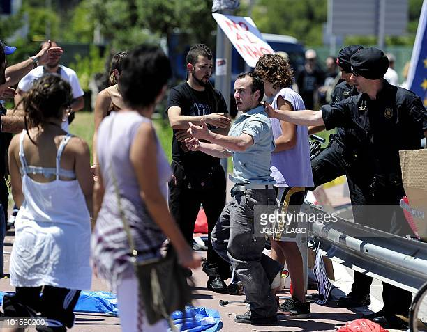 Policemen prevent activist to approach the Bilderberg Group meeting on June 3, 2010 in Sitges, near Barcelona. Police blocked the protesters from...