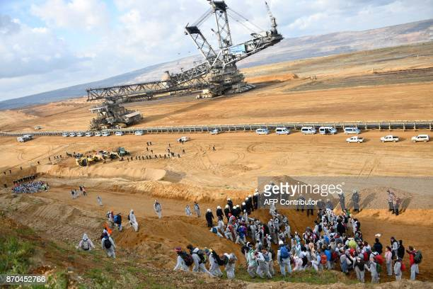 Policemen prevent environmentalist to march further after they managed to enter the Hambach lignite open pit mine near Elsdorf western Germany on...