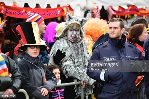 Policemen protect the annual Rose Monday parade on February 27 2017 in Mainz Germany Political satire is a traditional cornerstone of the annual...