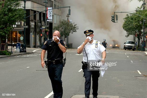 Policemen Protecting Themselves After Steam Pipe Explosion
