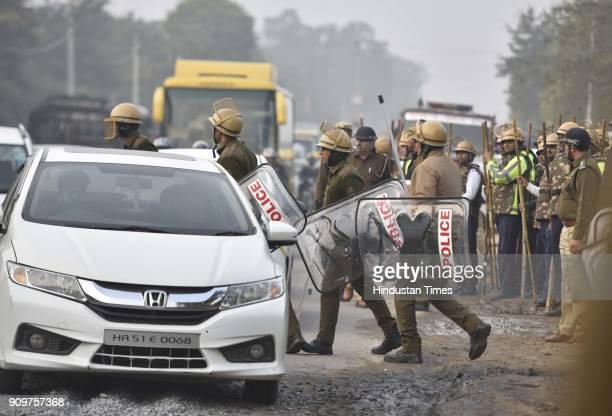 Policemen reach the spot where Haryana Roadways bus was set on fire near village Bhondsi allegedly by activists of Karni Sena who were protesting...