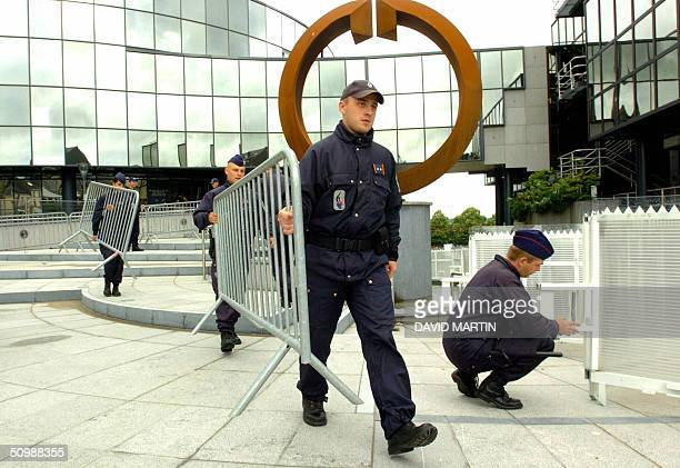 Policemen remove barriers installed outside Arlon's assize court after the trial of Belgian Marc Dutroux and his accomplices Michel Nihoul Michel...