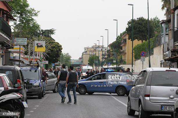 Policemen responding a shooting incident along Via Capodimonte in Naples in the neighborhood of Secondigliano After lengthy negotiations the man who...