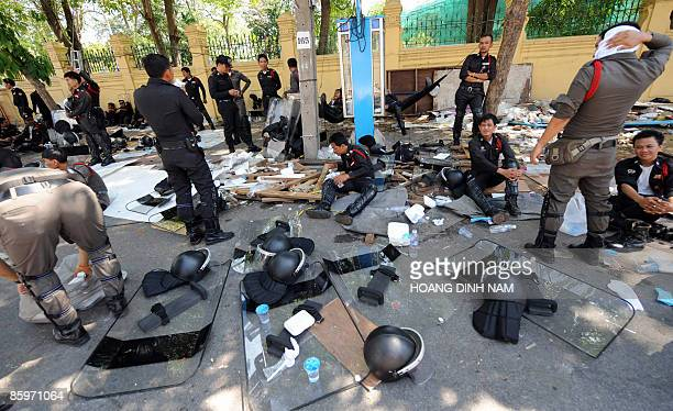 Policemen rest at the site of an antigovernment rally which has just been abandoned by protesters on a street leading to the government office in...