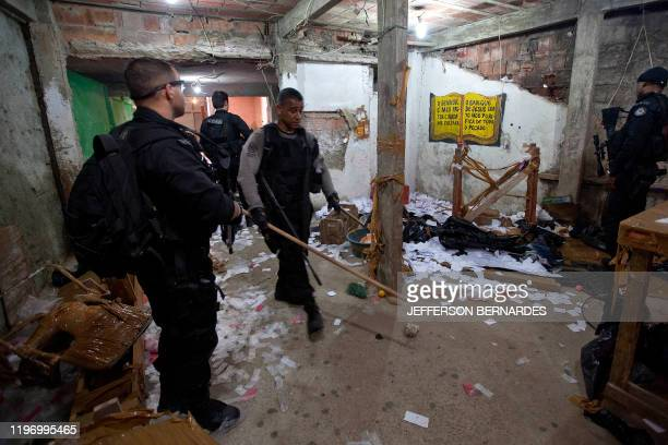 Policemen search a cocaine refining laboratory during the raid in the Morro do Alemao shantytown on November 28 2010 in Rio de Janeiro Brazil After...