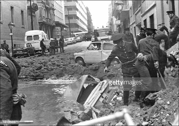 Policemen search among the damages caused by a bomb attack 20 December 1973 in which Prime Minister Luis Carrero Blanco has been killed The bomb has...