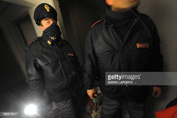 Policemen search for drugs in the vele blu building in the Scampia area in the suburb of Naples on January 28 2013 The northern Neapolitan suburb of...