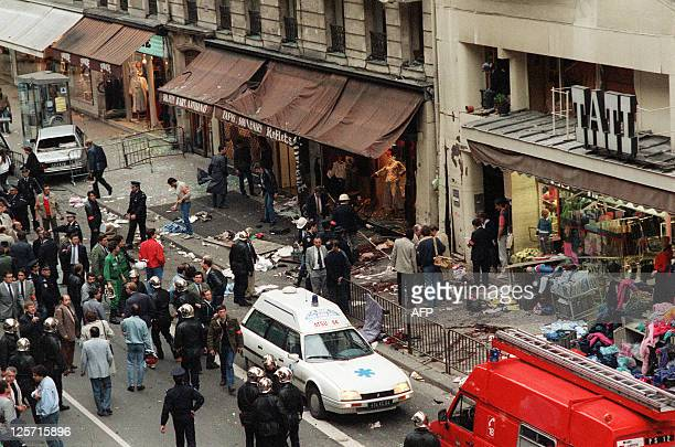 Policemen search for evidence on the site of the bomb blast in Rue de Rennes on September 17 1986 in front of Tati store Between December 7 1985 and...
