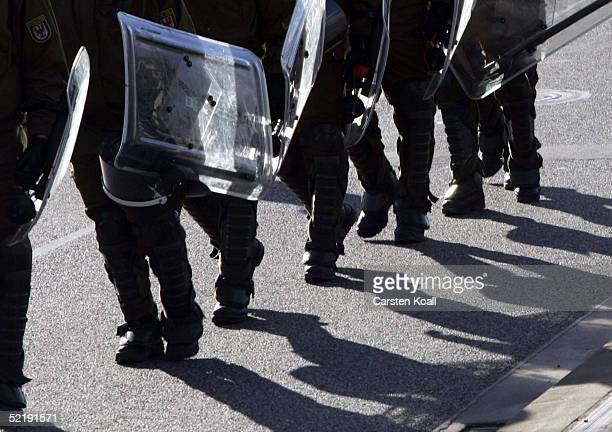 Policemen secure a NeoNazis march during the 60th anniversary of the firebombing of Dresden by Allied bombers during World War II on February 13 2005...