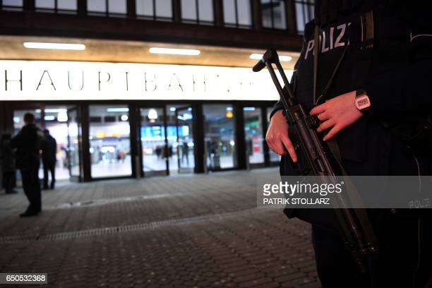 Policemen secure a train station after an axe attack on passengers at the main train station on March 9 2017 in Duesseldorf Germany Attackers...
