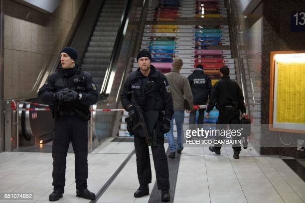 Policemen secure an access to a platform on March 10 2017 in Duesseldorf western Germany one day after German police have arrested an axewielding...