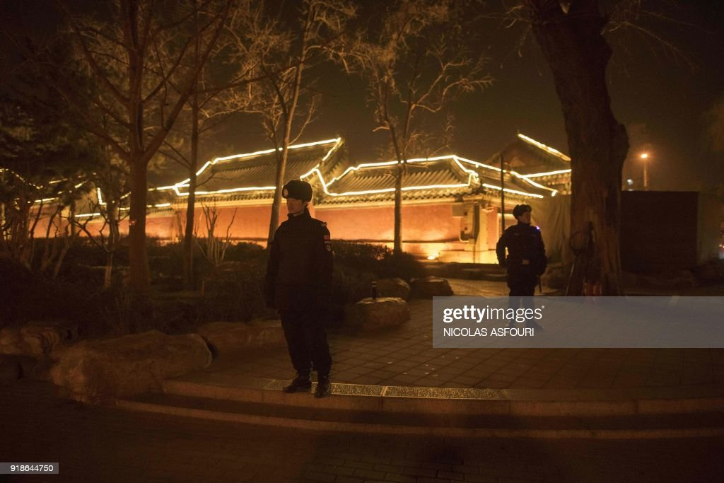 Policemen secure an area around Hou Hai lake in Beijing on February 15, 2018, ahead of the coming Lunar New Year, marking the Year of the Dog. Fireworks have been forbidden by the governement during the Lunar New Year in Beijing. The Lunar New Year falls on February 16 this year, with celebrations in China scheduled to last for a week. /