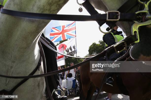 Policemen secure Pro and AntiBrexit demonstrations at Parlament Square in London England on Saturday September 7 2019 The protests took place amid...