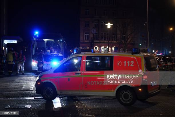 Policemen secure the area around a train station after an axe attack on passengers at the main train station on March 9 2017 in Duesseldorf Germany...