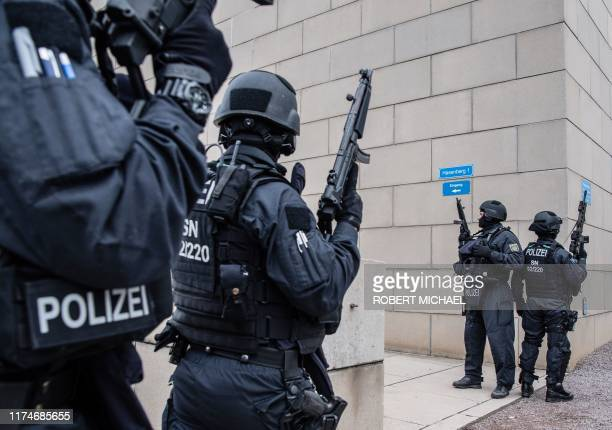 Policemen secure the area around the synagogue in Dresden on October 9 2019 At least two people were killed in a shooting on a street in the German...