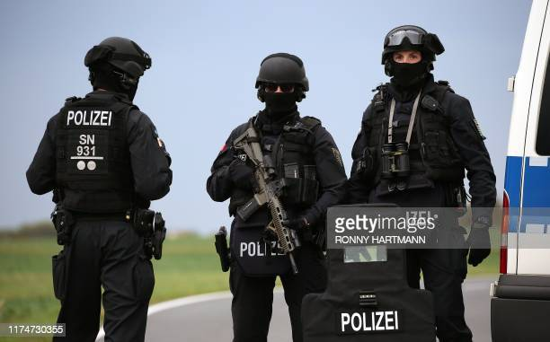Policemen secure the area between Wiedersdorf and Landsberg near Halle eastern Germany where shots were fired on October 9 2019 At least two people...