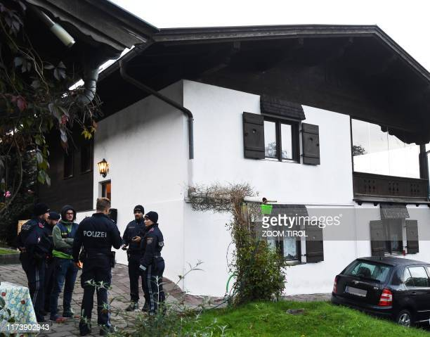 Policemen secure the crime scene around a house in Kitzbuehel Austria where five people were killed on October 6 2019 / Austria OUT