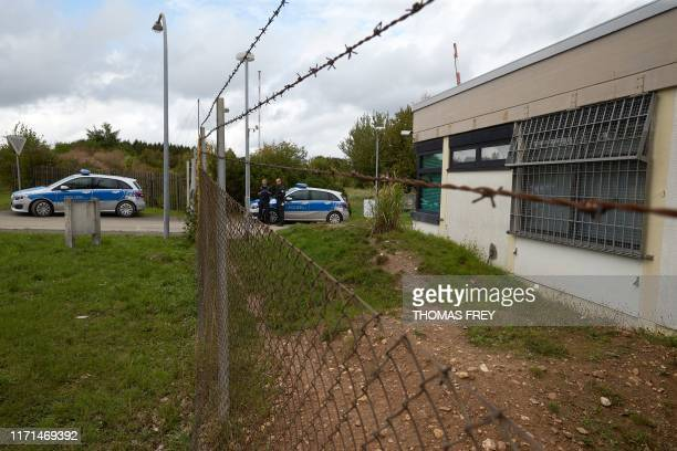 Policemen secure the grounds of a former NATO bunker on September 27 2019 in TrabenTrarbach western Germany where a socalled Bulletproof Hoster...