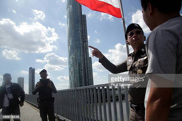 Policemen secure the site of an explosion near a busy train station in central Bangkok. A small device was thrown into a canal and exploded near a...