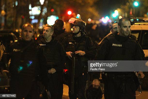 Policemen secured the vicinity in front Bataclan club during terrorist attack At least 129 people have been killed and over 200 injured 80 of which...