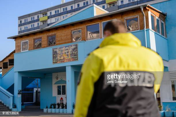 A policemen secures the Muslim cultural center and mosque following a recent attack just before the beginning of the visit of Aydan Ozoguz German...