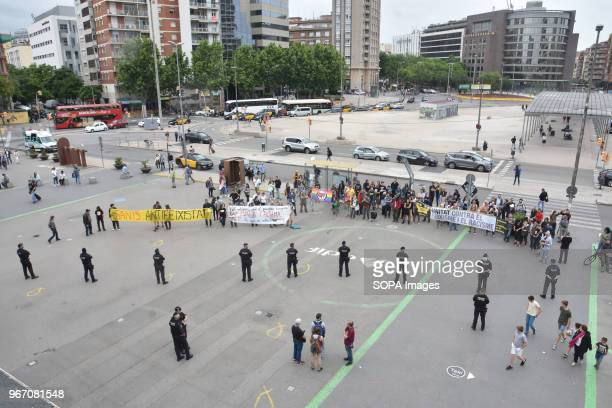 Policemen seen looking at the protesters during the demonstration Hundred UCFR supporters manifested in Barcelona against the political act of the...
