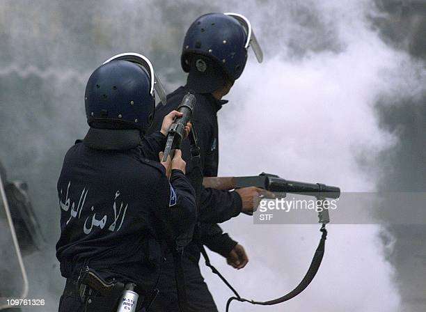 Policemen shoot teargas in the Tizi Ouzou city Algeria's northeastern Kabylie region 28 April 2001 Renewed riots broke in Algeria's northeastern...