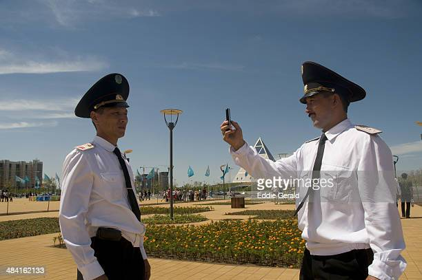 Policemen snapping each other with a cellular phone in Astana Kazakhstan