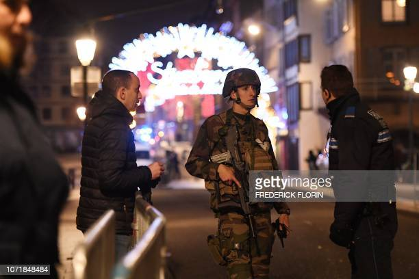 Policemen speak with a military in the streets of Strasbourg eastern France after a shooting breakout on December 11 2018 At least two people have...