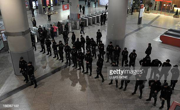 Policemen stand at Atocha train station during a general strike on November 14, 2012 in Madrid. General strikes in Spain and Portugal will spearhead...