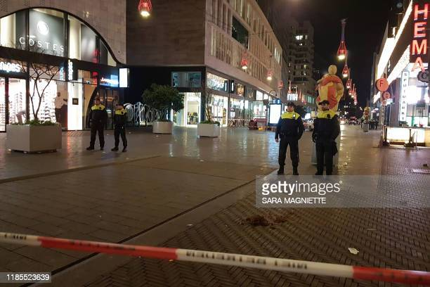 Policemen stand behind a cordoned off area at the Grote Marktstraat one of the main shopping streets in the centre of the Dutch city of The Hague...