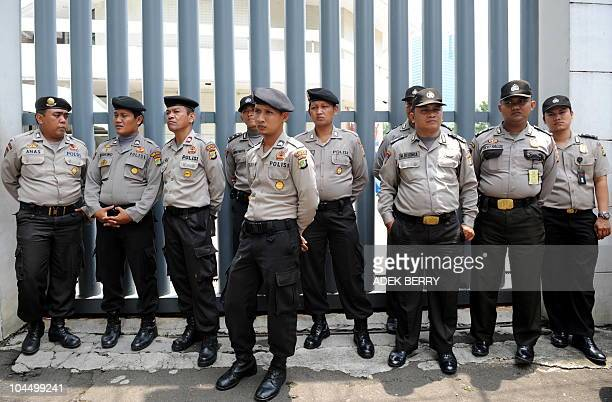 Policemen stand by as members of hardline Muslim group Front Pembela Islam the Islamic Defender Front protest against the Q Film Festival in front of...