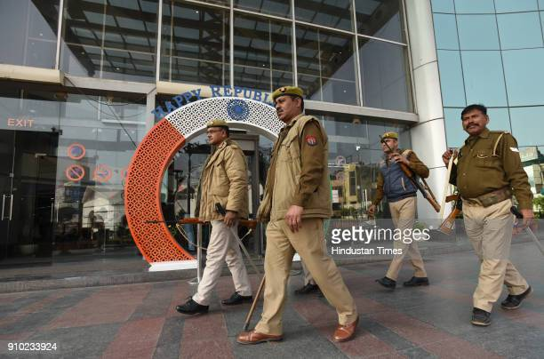 Policemen stand guard at Centre Stage mall during screening of the movie 'Padmaavat' on January 25 2018 in Noida India According to the film's maker...