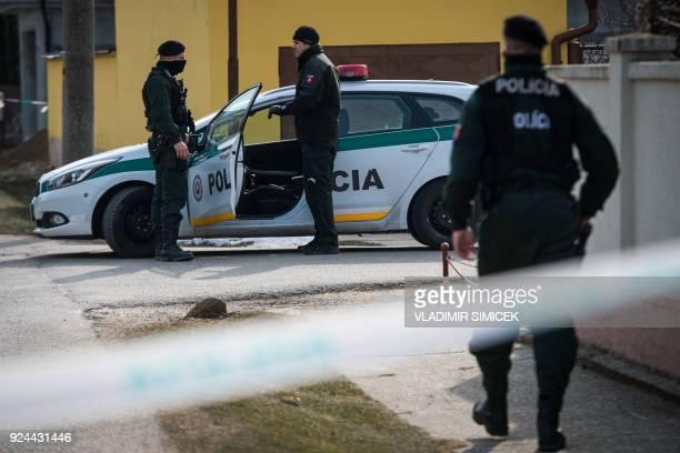 Policemen stand guard at the crime scene where Slovak investigative journalist Jan Kuciak and his girlfriend Marina Kusnirova were murdered in Velka...