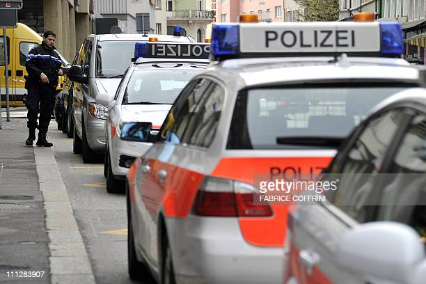 Policemen stand guard at the entrance of a building housing the Swiss nuclear power industry association in Olten on March 31 2011 Two people were...