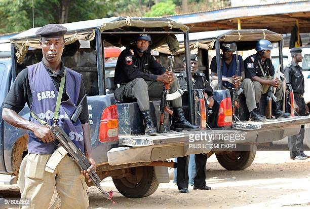Policemen stand guard at the police headquarters in Jos on March 10 2010 where suspects in the brutal religious killlings on March 5 in Dogo Nahawa...