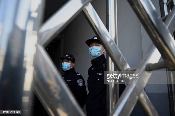 Policemen stand guard at the side entrance of the Dandong Intermediate People's Court, where Canadian businessman Michael Spavor will be on trial...