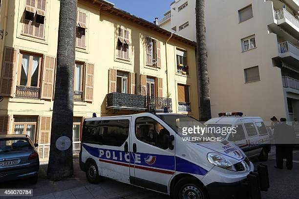 Policemen stand guard in front of the appartment building where lived Herve Gourdel on September 25 in Nice southeastern France following his...