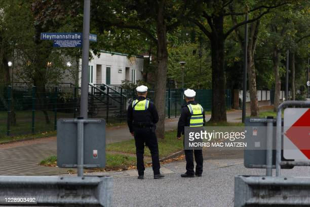 Policemen stand guard in front of the Synagoge 'Hohe Weide' in Hamburg, northern Germany, on Oktober 5 one day after an attack on a Jewish student. -...