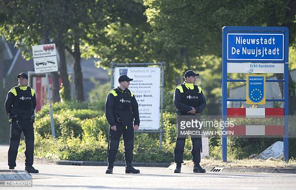 Policemen stand guard near the house of Bandidos president Harry Ramakers in Nieuwstadt on May 27 following his arrest as part of raids in southern...