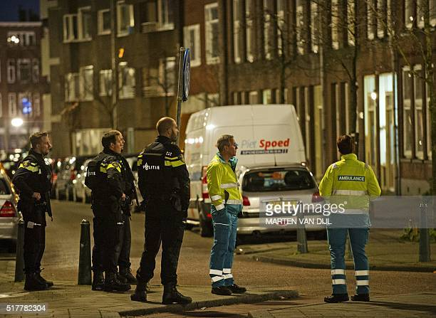 Policemen stand guard near the place where a 32yearold Frenchman was arrested at the request of French authorities over suspicsions of his...