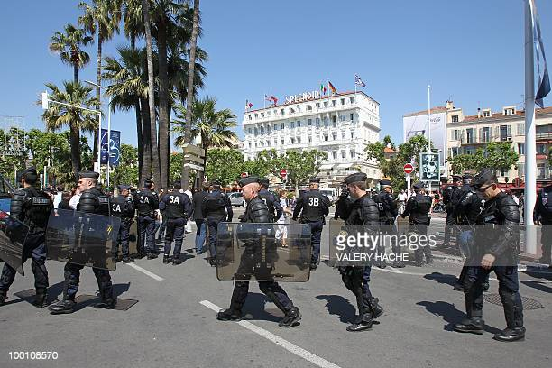 Policemen stand guard next to the Palais des Festivals during a protest against the film 'Outside Of The Law' by FrenchAlgerian director Rachid...