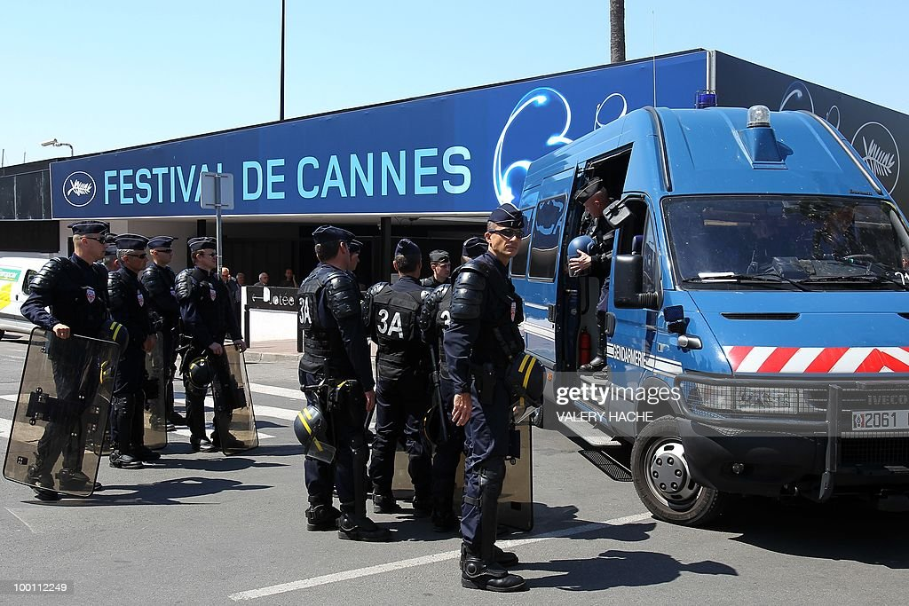 Policemen stand guard next to the Palais des Festivals during a protest against the film 'Outside Of The Law' by French-Algerian director Rachid Bouchareb, whom they accuse of distorting history, on the sidelines of the 63rd Cannes Film Festival on May 21, 2010 in Cannes. Opening with a massacre of Algerian civilians by French soldiers in the town of Setif in 1945 -- a controversial historical event which some critics say has been misrepresented -- the film is one of very few cinematic treatments of the conflict.