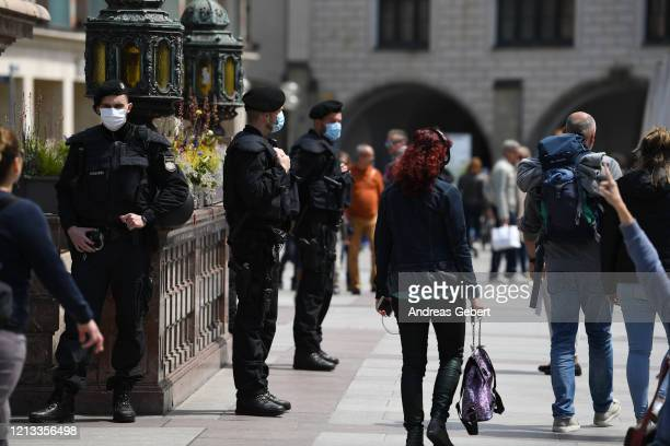 Policemen stand guard on Marienplatz on May 16, 2020 in Munich, Germany. As authorities continue to ease lockdown restrictions nationwide businesses...