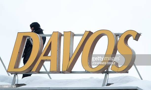 Policemen stand guard on the roof of the congress hotel on January 22 2013 at the Swiss resort of Davos The World Economic Forum will take place from...